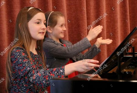 Alma Deutscher, Helen Deutscher Alma Deutscher and her sister Helen Deutscher, from left, play piano during a rehearsal in Vienna, Austria
