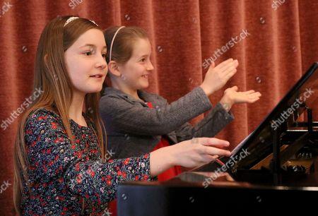 Alma Deutscher, Helen Deutscher Alma Deutscher and her sister Helen Deutscher, from left, play piano during a rehearsal in Vienna, Austria