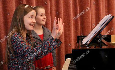 Alma Deutscher, Helen Deutscher Alma Deutscher and her sister Helen Deutscher, from left, plays piano during a rehearsal in Vienna, Austria