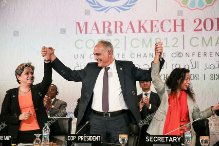 """U.N. climate chief Patricia Espinosa, right, Morocco's Foreign Minister Salaheddine Mezouar, centre, celebrate after the proclamation of Marrakech, at the COP22 climate change conference, in Marrakech, Morocco, . Governments meeting for U.N. climate talks have reiterated their commitment to the Paris Agreement with a proclamation saying climate action is """"irreversible,"""" the buzzword at the two-week conference after the uncertainty caused by the U.S. election"""