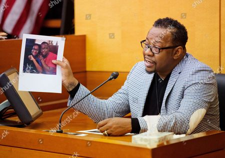 Bobby Brown Bobby Brown holds up a picture of his daughter, Bobbi Kristina Brown, during a wrongful death case against her partner, Nick Gordon, in Atlanta, . Brown, the celebrity daughter of singers Whitney Houston and Bobby Brown, was found face-down and unresponsive in a bathtub in her suburban Atlanta townhome in January 2015