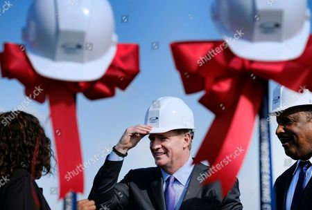 Stock Photo of Roger Goodell, James T. Butts Jr Inglewood Mayor James T. Butts Jr., right, watches as NFL Commissioner Roger Goodell puts on a hard had prior to the groundbreaking ceremony for the Los Angeles Rams' new stadium and entertainment district in Inglewood, Calif