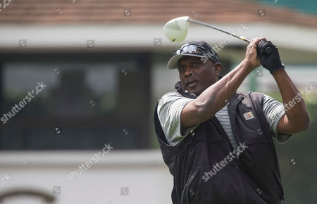 Tim Brown Tim Brown swings during a NFL Legends Golf Tournament in Mexico City, . The tournament was played at the Mexico Golf Club in support of the Lorena Ochoa Foundation