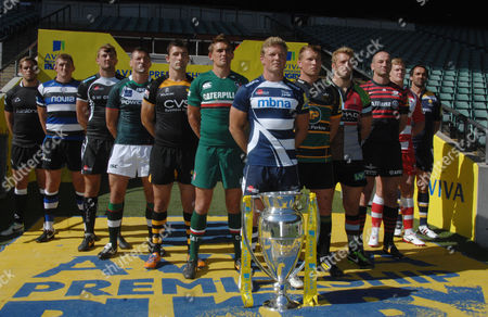 Rugby Union - 2013 / 2014 Aviva Premiership Rugby Launch Press Conference - Twickenham Daniel Braid (Sale Sharks) leads the line of Premiership Captains with the trophy Pictured are: Worcester Warriors' Jonathan Thomas Newcastle Falcon's Will Welch Bath's Stuart Hooper Exeter Chief's Dean Mumm London Irish's Declan Danaher London Wasps' Chris Bell Leicester Tigers' Toby Flood Sale Sharks' Daniel Braid Northampton Saint's Dylan Hartley Harlequins Chris Robshaw Saracens' Steve Borthwick Gloucester's Tom Savage
