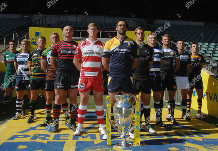 Rugby Union - 2013 / 2014 Aviva Premiership Rugby Launch Press Conference - Twickenham Jonathan Thomas (Worcester) leads the line of Premiership Captains with the trophy Pictured are: Worcester Warriors' Jonathan Thomas Newcastle Falcon's Will Welch Bath's Stuart Hooper Exeter Chief's Dean Mumm London Irish's Declan Danaher London Wasps' Chris Bell Leicester Tigers' Toby Flood Sale Sharks' Daniel Braid Northampton Saint's Dylan Hartley Harlequins Chris Robshaw Saracens' Steve Borthwick Gloucester's Tom Savage
