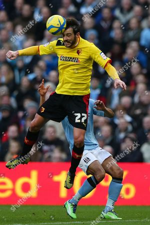 Football - 2012 / 2013 FA Cup - Third Round: Manchester City vs Watford Watford's Marco Cassetti heads the ball at Etihad Stadium Manchester Manchester, UK