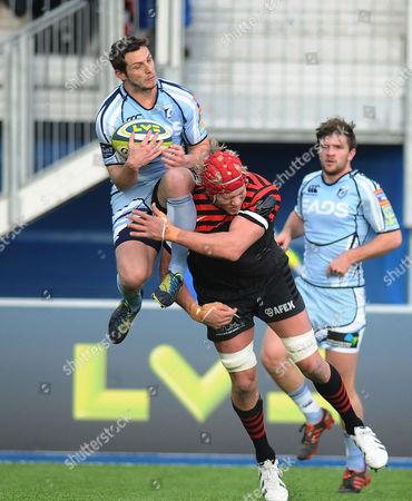 Rugby Union - 2012 / 2013 LV Cup - Saracens vs Cardiff Blues Mouritz Botha - Saracens challenges Jason Tovey - Cardiff at Allianz Stadium Barnet Copthall