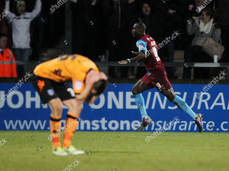 Stock Picture of Football - 2012 / 2013 npower League One - Scunthorpe United vs Portsmouth Scunthorpe's Akpo Sodje celebrates scoring the winning goal at Glanford Park