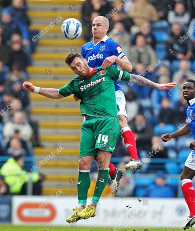 Football - 2012 / 2013 npower League One - Portsmouth vs Carlisle Portsmouth's Johnny Ertl battles with Carlisle's Lee Miller at Fratton Park