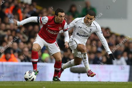 Football - 2012 / 2013 Premier League -Tottenham Hotspur vs Arsenal Tottenham's Kyle Walker and Santi Cazorla of Arsenal at White Hart Lane London London, UK