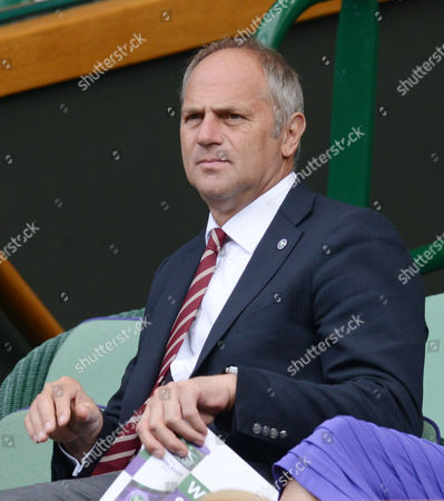 Stock Photo of Tennis - 2013 Wimbledon Championships - Centre Court Steven Redgrave - Ex Olympic Rowing Gold medalist watching from the Royal Box Great Britain
