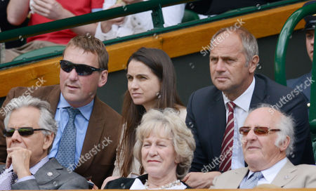 Stock Picture of Tennis - 2013 Wimbledon Championships - Centre Court Steven Redgrave and Matthew Pinsent - Ex Olympic Rowing Gold medalists watching from the Royal Box (Lady Pinsent) Demetra (Centre) Great Britain