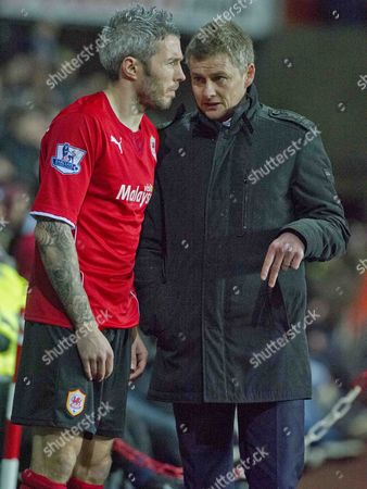 Football - 2013 / 2014 Premier League - Swansea City vs Cardiff City Ole Gunnar Solskjaer cardiff manager speaks to Kevin Mcnaughton as he comes on as a sub in the South Wales derby match at the Liberty Stadium  UK swansea