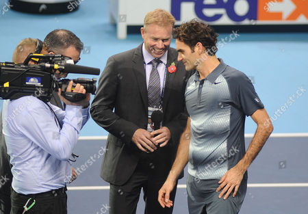Tennis - 2013 ATP World Tour Finals at The O2 - Day Four Roger Federer v Richard Gasquet Roger Federer talks to Sky television presenter Mark Petchey