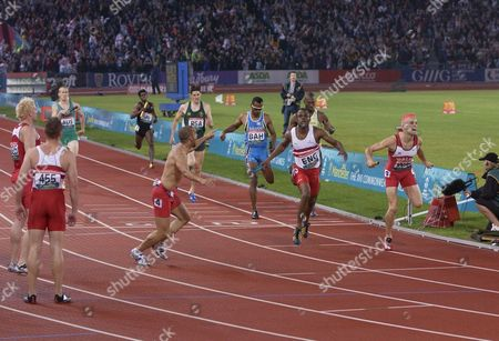 Athletics - 2002 Manchester Commonwealth Games - Men's 4x400m Relay Final England's Sean Baldock is joined by team-mates as he crosses the line to win the gold medal at the City of Manchester Stadium Wales' Matthew Elias right wins the silver