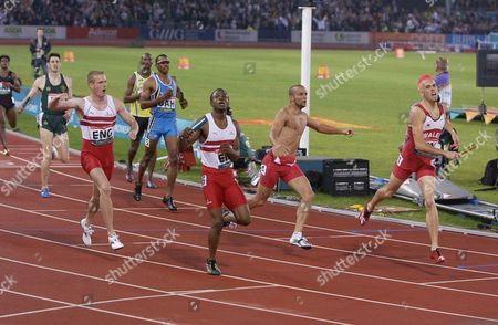 Stock Picture of Athletics - 2002 Manchester Commonwealth Games - Men's 4x400m Relay Final England's Sean Baldock is joined by team-mates as he crosses the line to win the gold medal at the City of Manchester Stadium Wales' Matthew Elias right wins the silver