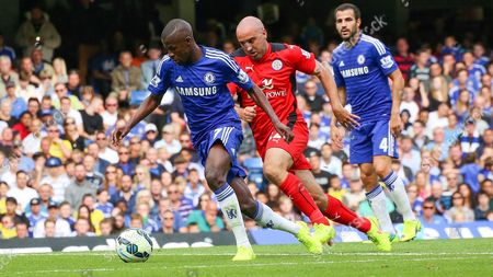Football - 2014 / 2015 Premier League - Chelsea vs Leicester City Ramires of Chelsea FC breaks away form Gary Taylor Fletcher of Leicester City at Stamford Bridge
