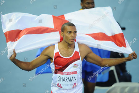 Athletics - 2014 Glasgow Commonwealth Games - Day Six Men's 110m Hurdles Final England's William Sharman celebrates with the England flag after winning the silver medal at Hampden Park