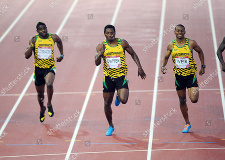 Athletics - 2014 Glasgow Commonwealth Games - Day Eight Men's 200m Final The Jamaican athletes who had a clean-sweep of the medals at Hampden Park Left to right: Jason Livermore (bronze) Rasheed Dwyer (gold) Warren Weir (bronze)