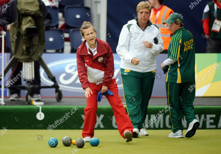 Stock Image of Lawn Bowls - 2014 Glasgow Commonwealth Games - Day Nine Women's Pairs Final: England vs South Africa England's Natalie Melmore on the way to winning silver at Kelvingrove Lawn Bowls Centre