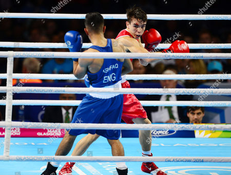 Boxing - 2014 Glasgow Commonwealth Games - Day Ten Men's Bantamweight [56kg] Final: Michael Conlan (Northern Ireland) vs Qais Ashfaq (England) Conlan (in red) on the way to defeating Ashfaq (in blue) at The SECC Hydro