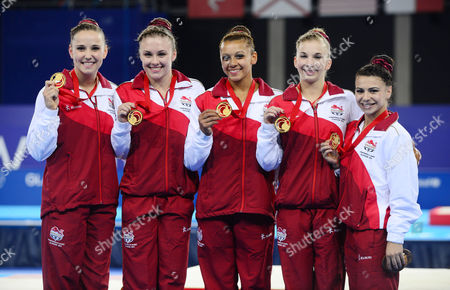 Gymnastics - 2014 Glasgow Commonwealth Games - Day Six Women's Artistic Team all-around Medal Presentation The England team with their gold medals at The SSE Hydro Left to right: Hannah Whelan Ruby Harold Rebecca Downie Kelly Simm and Claudia Fragapane