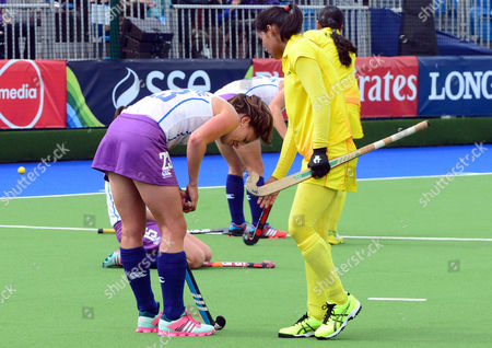 Hockey - 2014 Glasgow Commonwealth Games - Day Nine Women's Hockey Fifth and Sixth Place Classification: Scotland vs india Final whistle as Scotland's Emily Maguire is consoled by an Indian player at National Hockey Centre