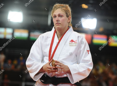 Judo - 2014 Glasgow Commonwealth Games - Day Three Women's Half-heavyweight [78kg] Final: Gemma Gibbons (England) vs Natalie Powell (Scotland) Gemma Gibbons with the silver medal shows her dejection after losing at the Scottish Exhibition and Conference Centre (SECC)
