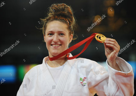 Judo - 2014 Glasgow Commonwealth Games - Day Three Women's Half-heavyweight [78kg] Final: Gemma Gibbons (England) vs Natalie Powell (Scotland) Natalie Powell shows her gold medal after victory at the Scottish Exhibition and Conference Centre (SECC)