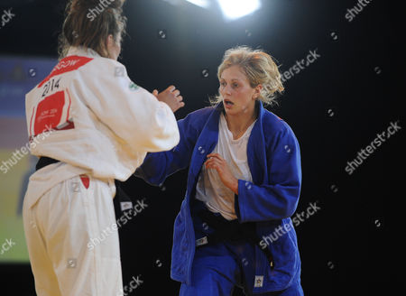 Judo - 2014 Glasgow Commonwealth Games - Day Three Women's Half-heavyweight [78kg] Final: Gemma Gibbons (England) vs Natalie Powell (Scotland) Natalie Powell (in white) takes on and Gemma Gibbons (in blue) at the Scottish Exhibition and Conference Centre (SECC)