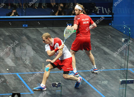 Stock Image of Squash - 2014 Glasgow Commonwealth Games - Day Five Men's Singles Final: Nick Matthew (England) vs James Willstrop (England) Matthew (in white) takes on Willstrop (in red) at Scotstoun Sports Campus