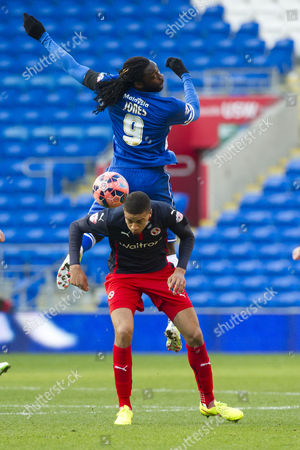 Football - 2014 / 2015 FA Cup - Fourth Round: Cardiff City vs Reading Kenwyne Jones & Frederico Macheda compete for the ball of Cardiff &at Cardiff City Stadium  UK swansea