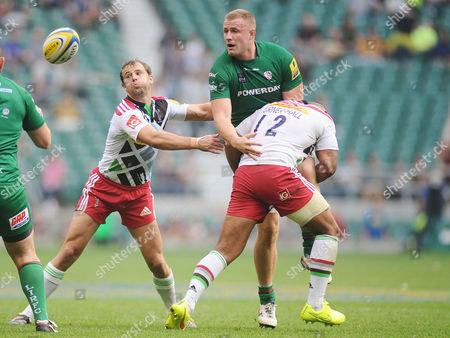 Rugby Union - 2014 / 2015 Aviva Premiership London Irish v Harlequins Harlequins Jordan Turner Hall tackles Kieran Low at Twickenham