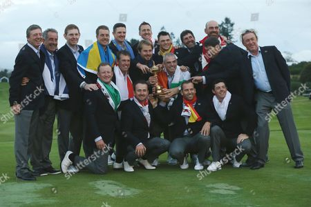 Golf - 2014 Ryder Cup - Sunday Singles Matches The European team celebrate with captain Paul McGinley and the trophy and the five vice-captains as they retain the Ryder Cup at Gleneagles Vice-captains are Des Smyth (back far left) Sam Torrance (back second left) Jose Maria Olazabal (back third right) Padraig Harrington (back second right) and Miguel Angel Jimenez (back far right) Players (in no order) are: Rory McIlroy Henrik Stenson Victor Dubuisson Jamie Donaldson Sergio Garc??a Justin Rose Martin Kaymer Thomas Bj??rn Graeme McDowell Stephen Gallacher Ian Poulter Lee Westwood  United KIngdom Auchterarder
