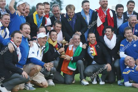 Golf - 2014 Ryder Cup - Sunday Singles Matches The victorious European team and captain Paul McGinley celebrate with their back-room staff after they retain the Ryder Cup at Gleneagles In no order: Vice-captains: Des Smyth Sam Torrance Jose Maria Olazabal Padraig Harrington Miguel Angel Jimenez Players: Rory McIlroy Henrik Stenson Victor Dubuisson Jamie Donaldson Sergio Garc??a Justin Rose Martin Kaymer Thomas Bj??rn Graeme McDowell Stephen Gallacher Ian Poulter Lee Westwood  United KIngdom Auchterarder