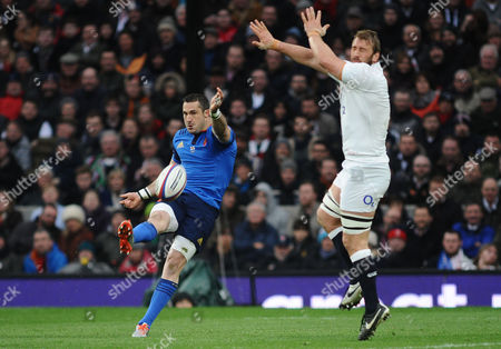Stock Picture of Rugby Union - 2015 Six Nations Championship - England vs France Scott Spedding of France kicks past Chris Robshaw at Twickenham 21/03/2015