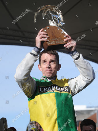 Horse Racing - 2015 Aintree Grand National Meeting - Grand National Day Leighton Aspell on Many Clouds celebrates with the trophy after winning the Grand National Leighton is first jock to ride successive winners since Brian Fletcher on Red Rum 1973 1974 & first to ride back-to-back winners since late Bryan Marshall on Early Mist & Royal Tan (1953 & 1954)