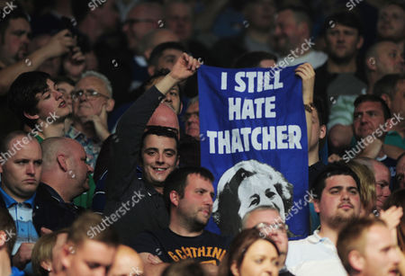Football - 2015 / 2016 Premier League - Leicester City vs Everton Leicester City fan with a banner still hate Maggie Thatcher inside the King Power Stadium  [Chelsea's draw with Tottenham earlier in the week had confirmed Leicester as league champions and this was the game they were presented with the Premier League trophy ]