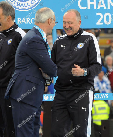 Stock Photo of Football - 2015 / 2016 Premier League - Leicester City vs Everton Leicester City manager Claudio Ranieri shares a joke with assistant Manager and head of Recruitment Steve Walsh during the presentation at the King Power Stadium  [Chelsea's draw with Tottenham earlier in the week had confirmed Leicester as league champions and this was the game they were presented with the Premier League trophy ]