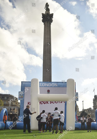 Rugby Union - 2015 RFU 'Find Rugby' Event - Trafalgar Square London 'Return to Rugby' Ambassador Lewis Moody coaches school children and club rugby players with Nelson's column in the background