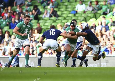 Rugby Union - 2015 World Cup warm-up - Ireland vs Scotland Ireland's Isaac Boss is tackled by Scotland's Blair Cowan right and Ross Ford left at the Aviva Stadium /KEN SUTTON Ireland 5554-1 Dublin