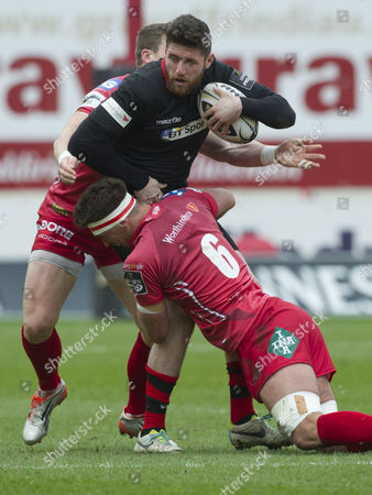 Rugby Union - 2014/2015 Guiness Pro12 - Scarlets vs Edinburgh Jack Cuthbert of Edinburgh tackled by Lewis Rawlins of the Scarlets at Parc y Scarlets  UK llanelli