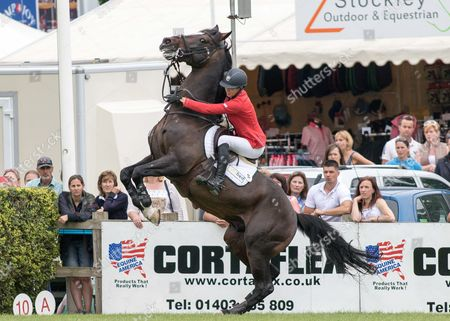 Stock Picture of Show Jumping - 2015 The Equestrian com Hickstead Derby Meeting The Equestrian com Derby Ellen Whittaker riding Locarno tries to keep her mount under control as it rears up at The All England Jumping Club Hickstead  GBR Hickstead
