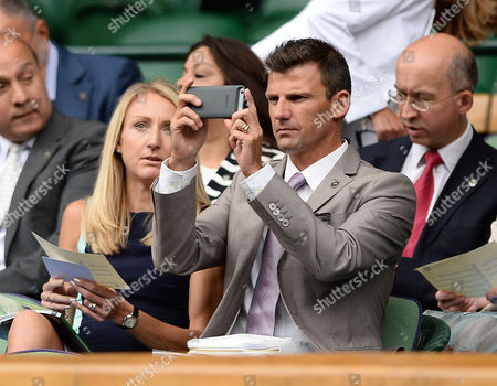Tennis - 2015 Wimbledon Championships - Week Two Wednesday [Day Nine] Men's Singles Quarter-Final Andy Murray (GBR) vs Vasek Pospisil (CAN) Paula Radcliffe and husband Gary Lough (her coach) taking a 'selfie' on Centre Court