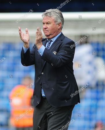 Football - 2015 / 2016 Premier League - Chelsea vs Leicester City Chelsea manager Guus Hiddink salutes the crowd after the match at Stamford Bridge
