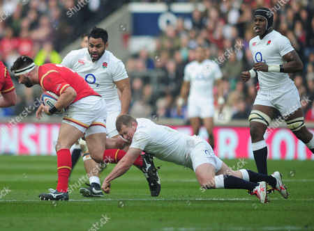 Rugby Union - 2016 Six Nations Championship - England vs Wales Scott Baldwin of Wales is tackled by Dylan Hartley of England as Billy Vunipola and Maro Itoje move in at Twickenham