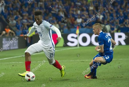 Football - 2016 UEFA European Championships [Euro 2016] - Round of 16: England v Iceland Daniel Sturridge of England attacks as Iceland's Ari Freyr Skulason attempts to defend at the Allianz Riviera Nice  France Nice