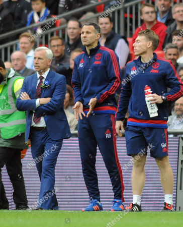 Football - 2016 FA Cup Final - Crystal Palace vs Manchester United Crystal Palace Manager Alan Pardew and Manchester United coach Ryan Giggs at Wembley Strength and conditioning coach Gary Walker right