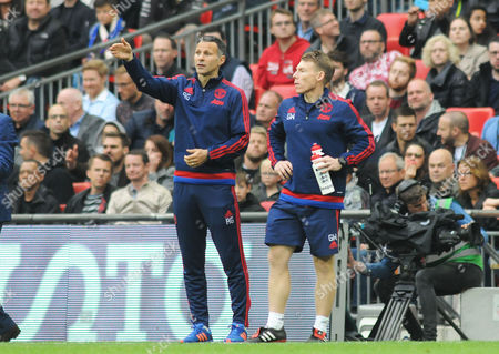 Stock Image of Football - 2016 FA Cup Final - Crystal Palace vs Manchester United Manchester United coach Ryan Giggs at Wembley Strength and conditioning coach Gary Walker right