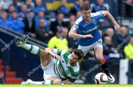 Football - 2015 / 2016 Scottish Cup - Semi-Final: Celtic vs Rangers Rangers' Andy Halliday and Celtic's Charles Mulgrew battle for the ball at Hampden Park Glasgow /JANE BARLOW United Kingdom Glasgow